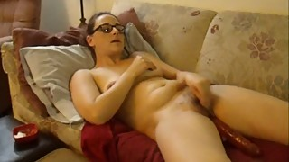 Wife masturating and fucking herself with a dildo
