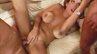 Milf housewife gets one cock in the ass and another in th puss