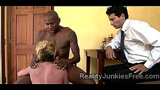 MILF rides big black cock in front of stunned husband